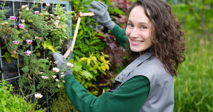 Young attractive landscaper woman